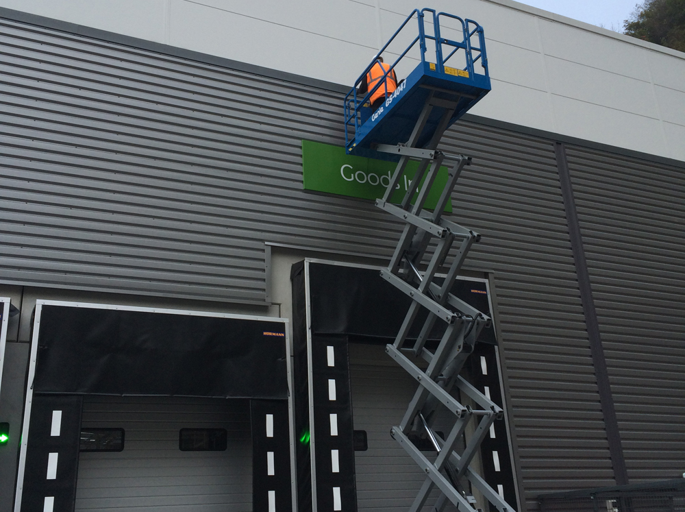 Safety ladder at the side of industrial building